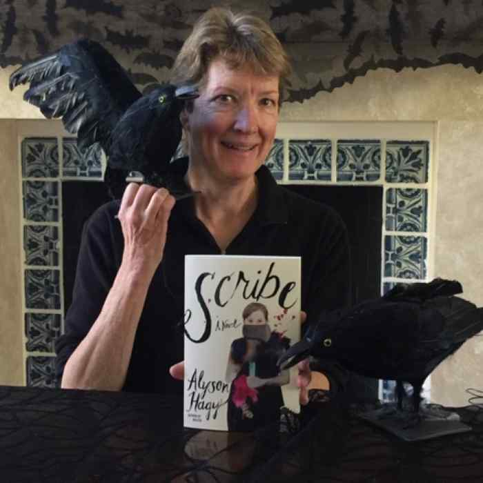 Alyson Hagy holding her book Scribe