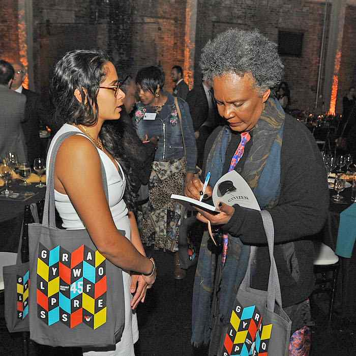 Claudia Rankine signing a copy of Citizen for a guest at the Graywolf Literary Gala