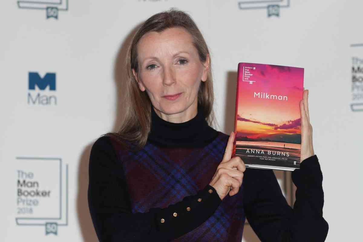Anna Burns holding her book Milkman