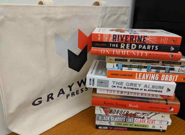 Graywolf Press tote bag and stack of books